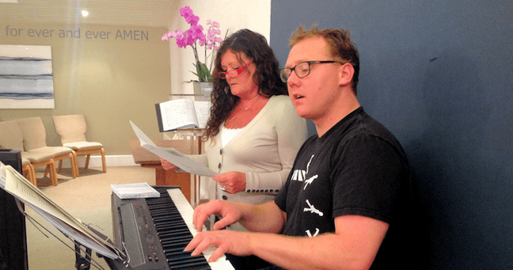 Toni and Jim running over a song after a rehearsal