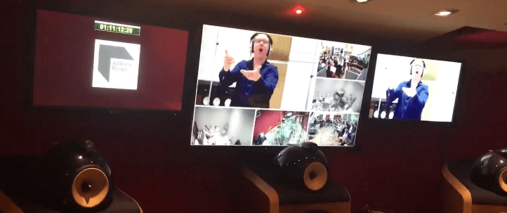 Jim Hawkins Choir Director leading at Abbey Road Studios as seen from the monitors in Studio 2 Control Room.